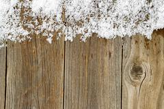 Christmas border decoration with snow on rustic wooden boards Kuvituskuvat