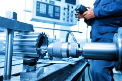 Man operating CNC drilling and boring machine. Industry - stock photo