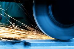 Stock Photo of Sparks from grinding machine. Industrial, industry