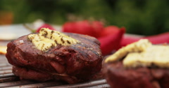 Beef steak medallions grilling on a barbecue with jalapeno peppers Stock Footage