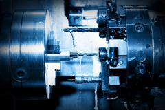 Industrial CNC drilling and boring machine at work - stock photo