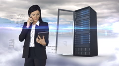 Businesswoman having phone call and holding tablet computer in front of server - stock footage