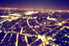 Big city night lights bokeh, blurred background. Vintage Stock Photos