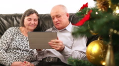 Senior couple using digital tablet at Christmas 3 Stock Footage
