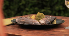 Grilled whole fish with lemon and rosemary on a plate Stock Footage