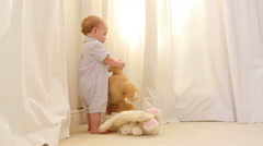 Little boy playing with teddy bears Stock Footage