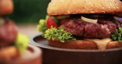 Big gourmet burger with fresh ingredients and prime beef patty Stock Footage