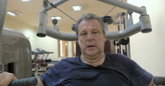 Man exercising on special sport equipment Stock Footage