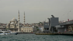 Galata bridge and the New Mosque in Istanbul Turkey Stock Footage