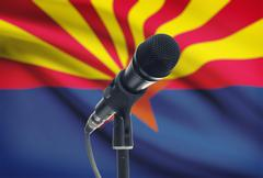 Stock Photo of Microphone with US states flags on background series - Arizona