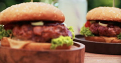 Gourmet burgers with prime beef patties looking fresh and delicious Stock Footage