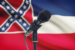 Stock Photo of Microphone with US states flags on background series - Mississippi