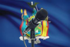 Stock Photo of Microphone with US states flags on background series - New York