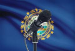 Microphone with US states flags on background series - New Hampshire - stock photo