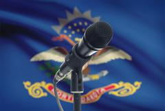 Microphone with US states flags on background series - North Dakota - stock photo