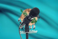 Microphone with US states flags on background series - Oklahoma - stock photo
