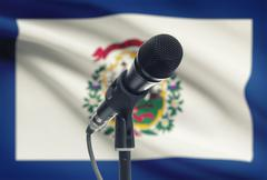 Microphone with US states flags on background series - West Virginia Stock Photos