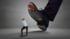 Shoes of giant boss trying to squash his scared employee Stock Footage