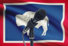 Microphone with US states flags on background series - Wyoming Stock Photos