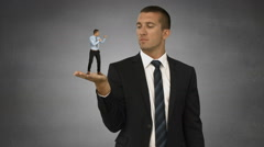Giant boss holding scared businessman Stock Footage