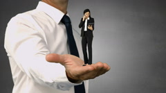 Giant businessman holding a businesswoman Stock Footage