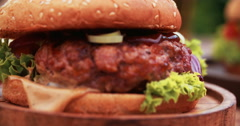 Gourmet cheese burgers with home made beef patties looking delicious Stock Footage