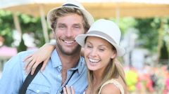 Cheerful couple of tourists with hat, summer vacation Stock Footage
