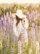Stock Photo of Attractive young woman and meadow