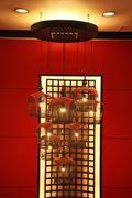 Wooden bird cage lamp Stock Photos