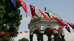 German fountain with Turkey flags in Istanbul Stock Footage