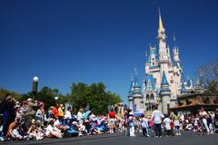 people at at Magic Kingdom  castle of Disney world - stock photo