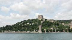 Rumelihisarı fortres from a ferry in Istanbul Turkey Stock Footage