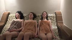 Three family female enjoy spa sauna steam bath. UHD steadycam 4K stock footag Stock Footage