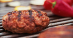 Quality beef patties grilling on a barbecue outdoors Stock Footage