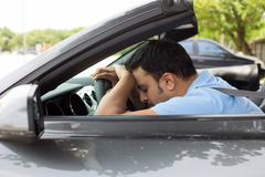 Closeup portrait tired young handsome man with short attention span, driving  - stock photo