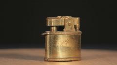 Brass lighter on black background, rotating Stock Footage