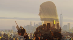 Wide slow motion double exposure shot of woman using cell phone over city Stock Footage