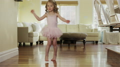Medium slow motion panning shot of girl dancing in ballerina costume / Cedar Stock Footage