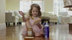 Medium shot of ballerina girl spreading peanut butter on bread / Cedar Hills, Stock Footage