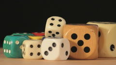 Colorful dice rotating on a black background - stock footage