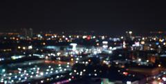 Blurred city lights bokeh illuminated at night Stock Photos