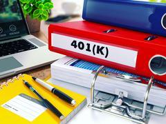 Stock Illustration of 401K on Red Ring Binder. Blurred, Toned Image