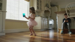 Medium slow motion panning shot of children playing in kitchen / Cedar Hills, Stock Footage