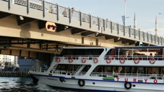 Ferry passing by under the galata brigde in Istanbul Turkey Stock Footage