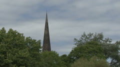 Church spire beyond trees. Stock Footage