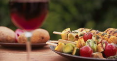 Plate of healthy grilled vegetables on a wooden table outdoors Stock Footage