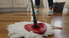Close up shot of woman mopping ketchup on kitchen floor / Cedar Hills, Utah, Stock Footage