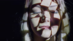 Close up shot of squares projected on woman's face / Cedar Hills, Utah, United Stock Footage