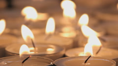 Group of burning tea light candles, with rotating candles in the middle Stock Footage