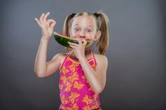 Watermelon eating without teeth.. - stock photo